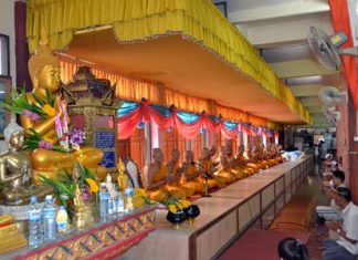 Over 20 monks from Bunsamphan temple wish luck upon the citizens attending the merit making ceremony at the end of Buddhist Lent.