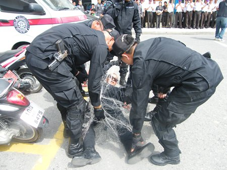 Police recruits learned suppression techniques during a training session in Pattaya.