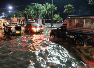 """High winds and heavy rains slammed into Pattaya Saturday night, Oct. 11, knocking down trees and power lines, flooding a large part of the city, and leaving a tangled mess in its wake. The storm hit the heaviest during """"prime time"""" when weekend traffic was already at its worst. Shown here, Beach Road Pattaya was nearly at a standstill as floodwaters ripped across the road towards the sea."""