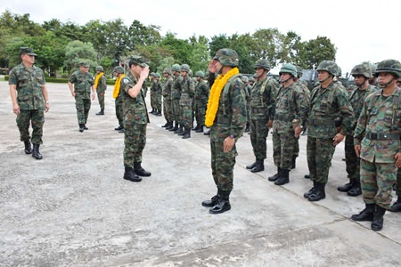 Rear Adm. Luechai Ruddit sends off troops to the south, wishing them the best and to come back safely.