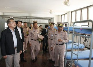Education Minister Narong Phipatanasai inspects the barracks where college students will be interned for a month-long camp aimed at teaching them discipline, morals and ethics.