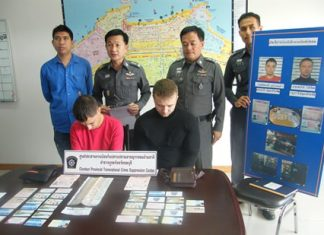 Evgenii Kurbatov (left) and Sergei Popov (right) were apprehended with 36 fake ATM cards and cash.
