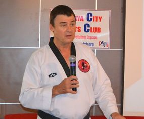 Scott Rohr explains to his PCEC audience that they can learn a few martial arts manoeuvres which can be used for self defence; they do not rely on strength, but on skill that can be learned without regard to age and gender.