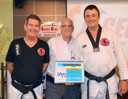 MC Richard Silverberg presents the PCEC's Certificate of Appreciation to Scott Rohr for his presentation and thanks member Jim Jones for his able assistance.