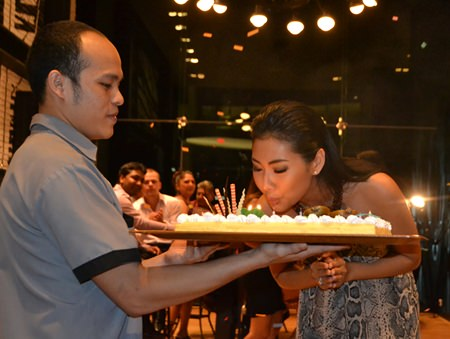 Kamonrat Ladseeta (Emmy) blows out the candles on her birthday cake.