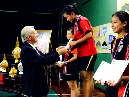 William Macey, Charity Chairman of the PSC, presents medals to the under-16 girls winners.