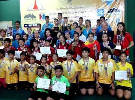 Young champions and medal winners pose for a group photo.