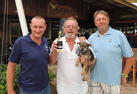 Tony Aslett (centre) celebrates his victory on Friday flanked by Greg Hirst (sponsor left) and the runner up, Peter LeNoury.