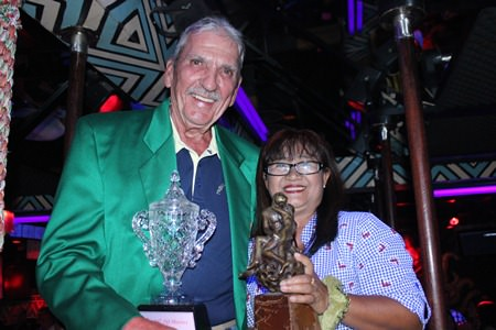 Butch Porter (left) receives the TQ Masters champion's trophy and Green Jacket from Mamasan Ead.
