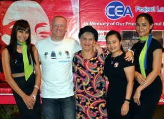 "Pattaya Soul Club founders Earl Brown (2nd left) and Eva Johnson (centre) pose with the Riviera Group girls at the anniversary ""Souled Out"" party on November 8 at the Access Inn, Pattaya."