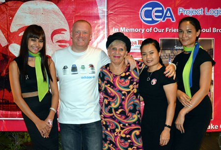 """Pattaya Soul Club founders Earl Brown (2nd left) and Eva Johnson (centre) pose with the Riviera Group girls at the anniversary """"Souled Out"""" party on November 8 at the Access Inn, Pattaya."""