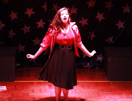 Betty Rizzo belts out a song as part of GIS's Grease production.