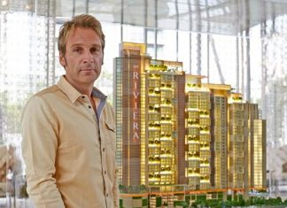 Developer Winston Gale stands next to a scale model of the The Riviera Jomtien project.
