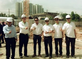 Somchao Tanthatherdthum (2nd left), Managing Director of NC Housing Co., Ltd., stands with fellow company directors and project managers during the ground-breaking ceremony for phase 2 of the Natureza Condominium.