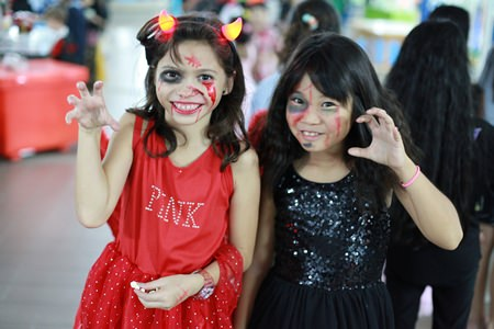 These two horrors had fun during Halloween at Garden International School.