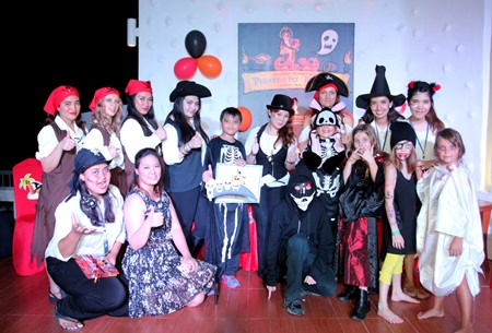 Maria Gequillana (back row, 4th right), Royal Cliff Hotels Group's PR and Marketing Communications Manager, and Ralph Monica Angeles (back row, 4th left), Funtasea Kids World and The Verge:  Games, Pool and Lounge Manager, stand for a photo with the Royal Cliff pirate team and guests in charming costumes at the spooktacular Pirates@ the Cliff Halloween Party at Breezeo - Be Yourself Dining.