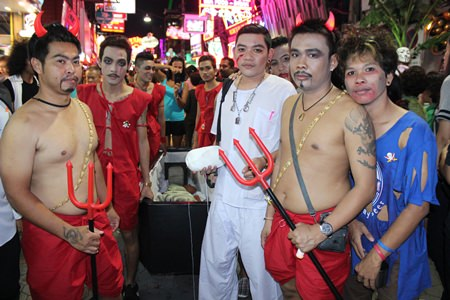 Costumes with a message - these devil disciples parade down Walking Street with a full coffin as a reminder to not drink and drive.