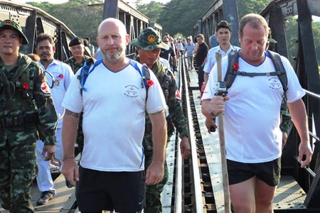 The walkers Richard Stacey and Gary Grand finish at the Bridge over the River Kwai.