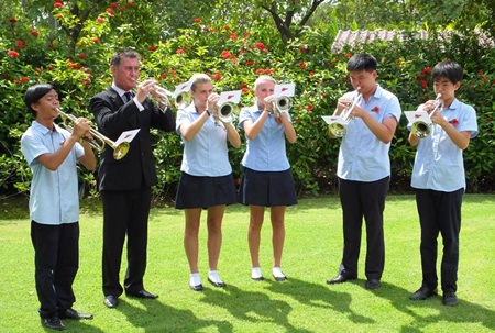 Students from Regents Pattaya play Last Post at Chung Kai War Cemetery.
