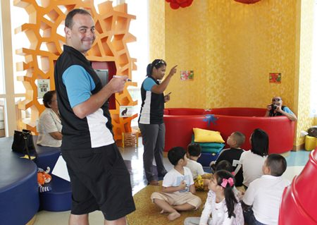 Mr Jamie and his assistant Khun Ning guide the children through activities.