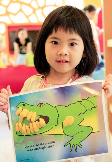 One of the young guests with her masterpiece.
