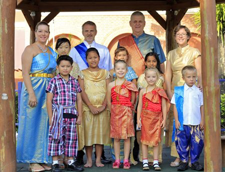Staff and students in traditional Thai dress.