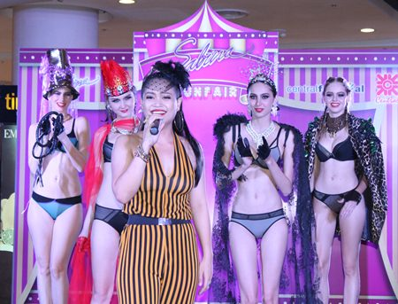 Vocalist Wanlika (Taengmo) Kertsawapitak performs for the crowd as lingerie models look on.