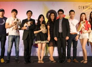 """Pattaya City Council Vice President Rattanachai Sutidechanai and Central Center Pattaya General Manager Sajan Nhakbhun preside over the opening ceremony of """"The Musical Festival"""" for dogs and dog lovers."""