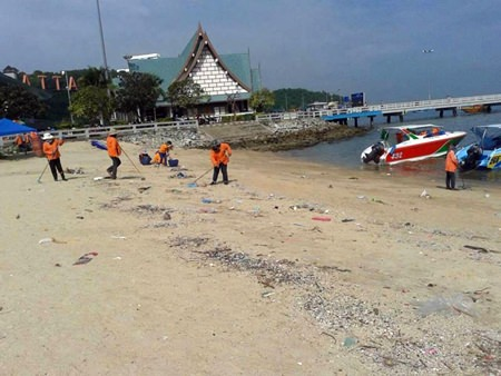 City workers from Pattaya's Environmental Department clean the beach near Bali Hai Pier and Siam Bayshore.