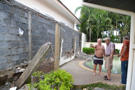 The roofs of a new housing project have been built so close to the boundary, when it rains, large amounts of water pours into the homes of residents in Green Field Villa 2.  The wall the contractor created also fell down.