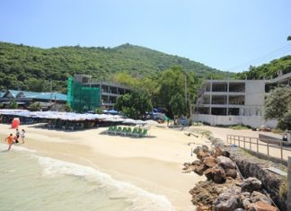 Banglamung District Chief Sakchai Taengho is investigating how developers of this hotel and restaurant under construction on Koh Larn's Tawaen Beach gained approval for their project which is being built on public land.