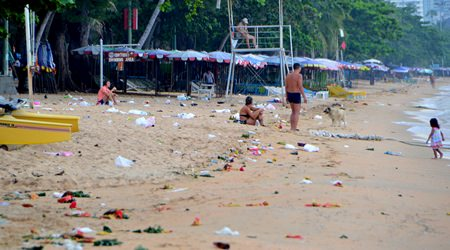 Jomtien Beach was littered with floats, balloons, discarded bottles, bags and food containers left behind by revelers.