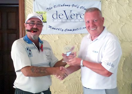 Owen Walkley receives the deVere trophy for October from Brian Chapman.