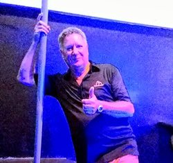 Nev sizes up the dancing pole.
