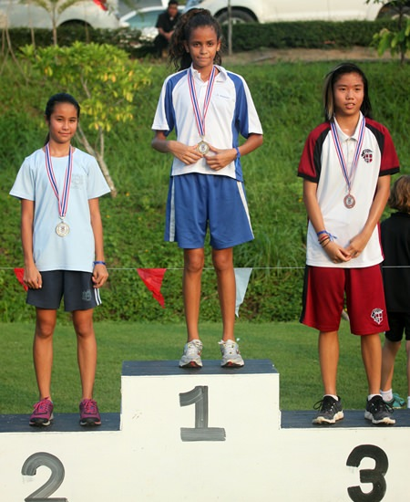 Keisharna Lucas (centre) dominated the under 13 girls event and took the gold medal.
