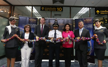 (Left to right) Anoma Vongyai, Tourism Authority of Thailand Director - Phuket Office; Craig Thomas, Etihad Airways Vice President Asia Pacific North and Indian Sub-Continent; Captain Adel Al Zubaidi; Monruedee Ketphan, Director of Phuket International Airport; Dimitrios Karagkioules, Etihad Airways new General Manager for Thailand; and Etihad Airways cabin crew celebrate the airline's inaugural Phuket to Abu Dhabi flight with a floral garland cutting ceremony at Phuket International Airport.