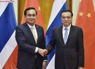 Chinese Premier Li Keqiang (R) shakes hands with visiting Thai Prime Minister Prayuth Chan-ocha before their talks in Beijing, capital of China, Dec. 22, 2014. (Xinhua/Xie Huanchi)