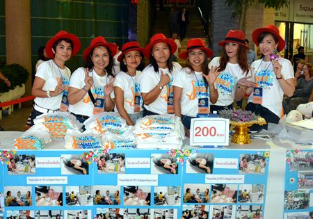 "Members of the YWCA Bangkok-Pattaya sold ""Let's Jazz @ Pattaya"" T-shirts to raise funds for the ""Make Dreams True"" project."