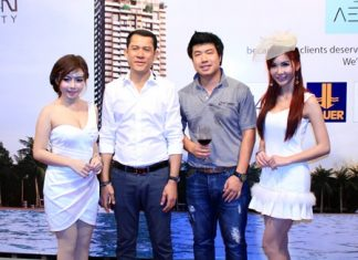Saksit Teerapornsathanon (2nd left) and Suriwat Rermkitkarn (3rd left), deputy managing directors of the Urban Property, pose for a photo during the Aeras Condominium 'thank-you' party on November 25.