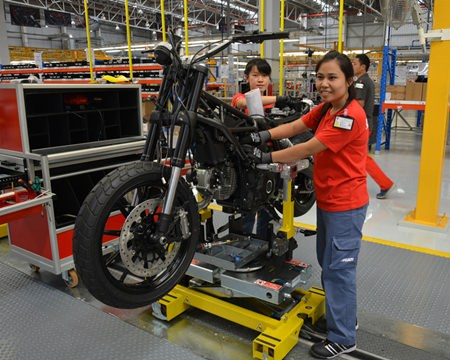 Ducati employees show how they produce a Ducati Motorbike.