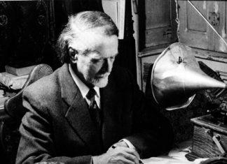Zoltán Kodály analysing folk-song recordings.