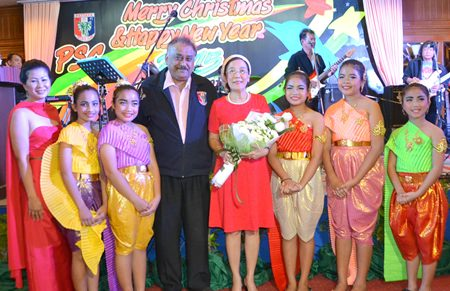 Noi, Peter and Khun Toy pose with the exquisite dancers from the Pattaya Orphanage.