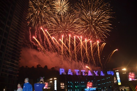 A grand fireworks show behind the Pattaya City sign lights up the beginning of Pattaya's Countdown to 2015.