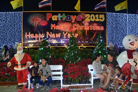 Families pose with Santa and Frosty in Central Pattaya.