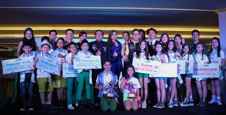 Winners, judges, guests and sponsors pose after taking a bow on stage.