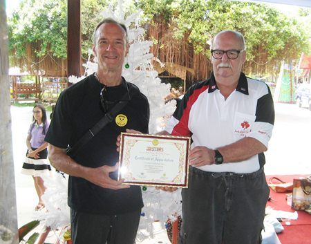 Woody presents Wayne Ogonoski of the Jackalope with the Care for Kids 2014 Certificate of Appreciation.