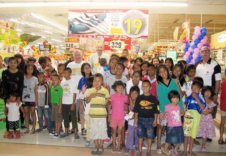 The children and sponsors pose for a group photo before letting the kids loose on their shopping trip inside Big C.