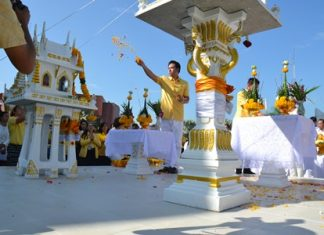 Mayor Itthiphol Kunplome leads the inauguration of the Brahman shrine with accompanying joss house and spirit house at city hall.
