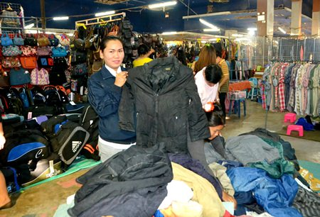 Vendors at the Grand Hall Market near Friendship Supermarket have brought out coats and warm clothes to sell.