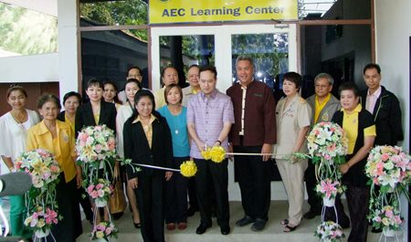 Officials cut the ribbon to officially open the new AEC Learning Center.